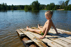 Little girl sits on a raft Stock Photos