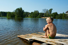 Little girl sits on a raft royalty free stock photos