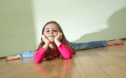 Little girl sits on a splits Royalty Free Stock Photo