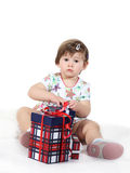 Little girl sits with three gift boxes Stock Photo