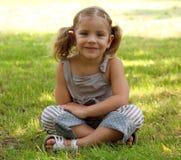 Little girl sitting Royalty Free Stock Photo