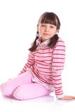 Little girl sitting Stock Photo