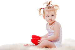 Little girl sitting. Adorable little girl sitting in a warm bed isolated on white stock photography