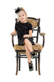 Little Girl Sitting in Antique Chair Stock Image