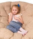Little girl sitting in armchair Royalty Free Stock Photography
