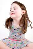 Little Girl sitting with arms behind her back Royalty Free Stock Images