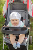 Little girl sitting in a baby carriage Royalty Free Stock Photography