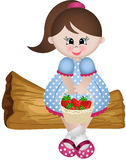 Little girl sitting with basket strawberries Stock Images