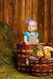 Little girl sitting basket royalty free stock photos