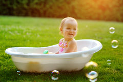 Little girl sitting in the bath Stock Photography