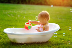 Little girl sitting in the bath Royalty Free Stock Images