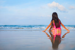 Little girl sitting in beach Royalty Free Stock Image