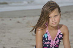 Little Girl Sitting At Beach Royalty Free Stock Image