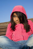 Little girl sitting on the bench Stock Photo