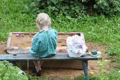 A little girl sitting in bench Royalty Free Stock Photography