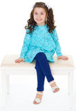 Little girl sitting on the bench Royalty Free Stock Photos