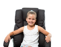 Little girl sitting in big armchair Royalty Free Stock Photography