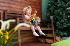The little girl is sitting and smiling royalty free stock image