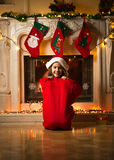Little girl sitting in big red bag for gifts at Christmas eve Royalty Free Stock Photography
