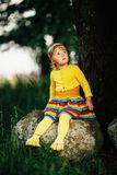 Little girl sitting on big stone Royalty Free Stock Image