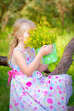 Little girl sitting on a branch of a tree  Royalty Free Stock Photos