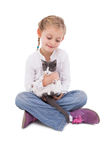 Little girl sitting with cat in her arms Royalty Free Stock Image