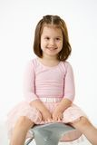 Little girl sitting on chair Stock Image