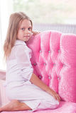 Little girl sitting on the chair Stock Photography