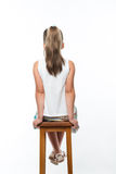 Little girl sitting on chair Stock Photography