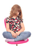 Little girl sitting on chair Royalty Free Stock Photos
