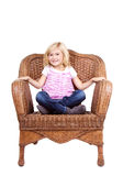 Little girl sitting on a chair Royalty Free Stock Image
