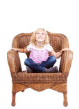 Little girl sitting on a chair Stock Images