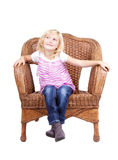 Little girl sitting on a chair Stock Photography