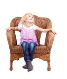 Little girl sitting on a chair Royalty Free Stock Photo