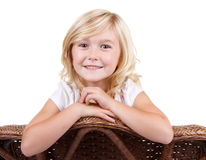 Little girl sitting on a chair Royalty Free Stock Photography
