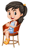 Little girl sitting on chair Royalty Free Stock Photography