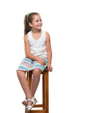 Little girl sitting on the chair Stock Image