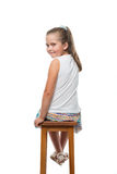 little girl sitting on chair looking back Royalty Free Stock Images