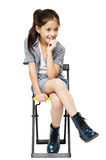Little girl sitting on chair portrait Stock Photography