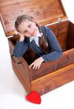 Little girl sitting in chest Royalty Free Stock Photos