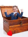 Little girl sitting in chest Royalty Free Stock Images