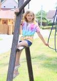 Little girl sitting on a construction Stock Photos