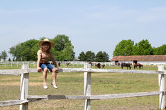 Little girl sitting on corral Royalty Free Stock Photography