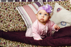 Little girl sitting on couch Royalty Free Stock Photography
