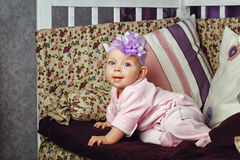 Little girl sitting on couch Royalty Free Stock Image