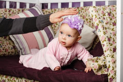 Little girl sitting on couch Stock Images