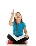 Little girl sitting cross legged and learning Stock Image