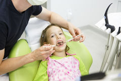 Little girl sitting on dental chair Stock Photography
