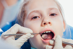 Little girl sitting in the dentists office Stock Photos
