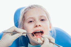 Little girl sitting in the dentists office Royalty Free Stock Images